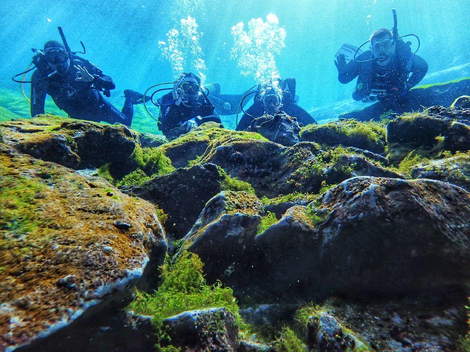 divers at cavern entrance